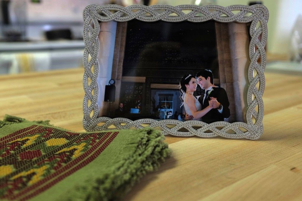 On our kitchen counter: coasters from Guatemala and a photo from our wedding.