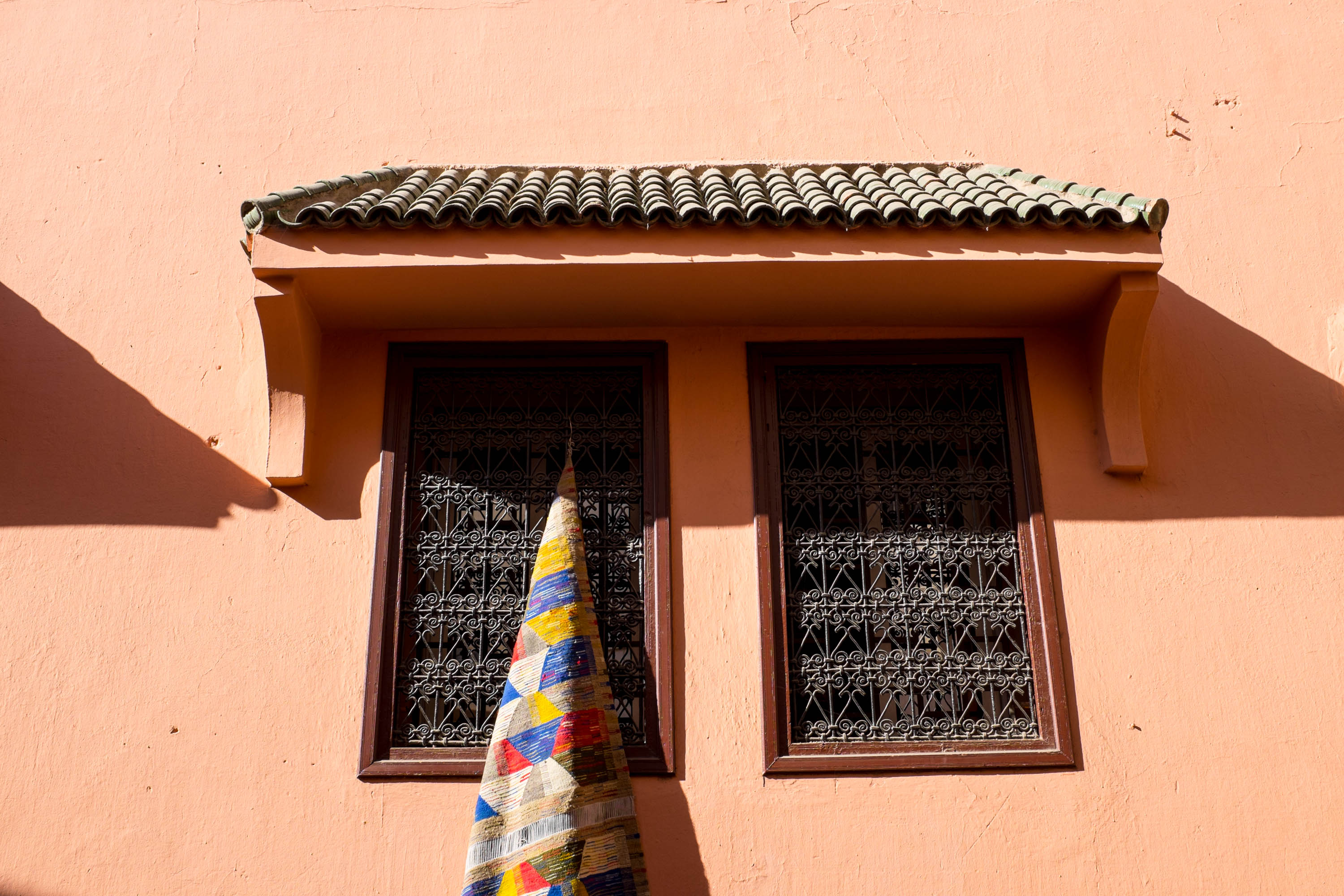 Beautiful rug on window | | Marrakech: a quick guide
